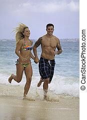 newly wed couple on the beach at Lanikai, Hawaii