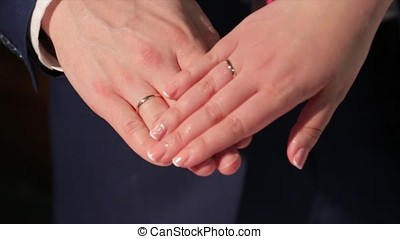 Newly wed couple's hands with wedding rings. Bride and groom with wedding rings. Hands and rings on wedding bouquet. Hands of the groom and the bride. Holydays. Wedding family, bride, groom and their children walking in the autumn park at wedding day. Wife and husband repeated wedding day photo shoot, but with children. Love