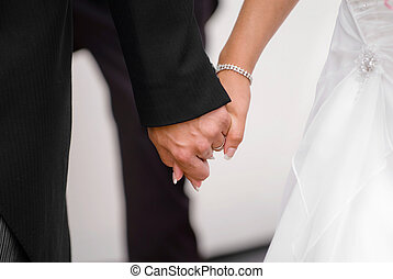 Just married couple holding hands on there journing together.