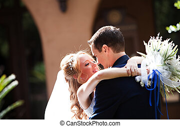 A newlywed couple enjoy their wedding day in the United States