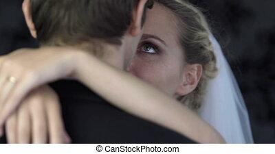 Newlywed couple hugging and dancing
