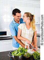 newlywed couple in modern kitchen