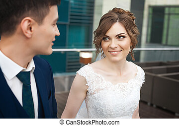 newlywed couple looking at each other in restaurant
