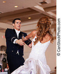 Newlywed First Dance - A newlywed couple enjoy their wedding...