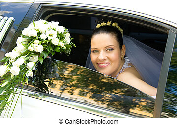 Newlywed - Portrait of happy bride in car window with...