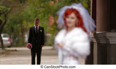 Newlywed posing for cameras