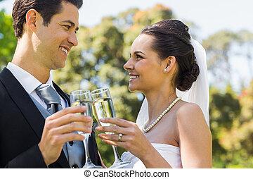 Newlywed toasting champagne flutes