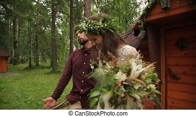 Newlyweds after wedding ceremony nature - Happy couple front...