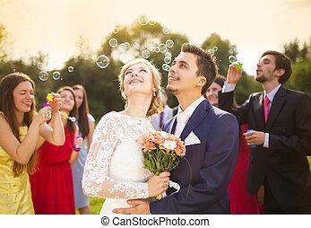 Newlyweds at wedding reception - Young newlyweds enjoying...