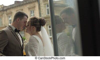 Newlyweds. Caucasian groom with bride dancing on balcony. ...