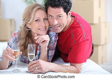 newlyweds celebrating new home