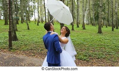 newlyweds, couple of happy newlyweds on summer park