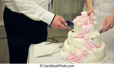newlyweds cutting cake with blue flower