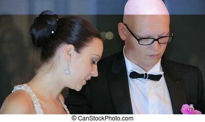 Newlyweds Cutting Wedding Cake - Portrait of beautiful young...