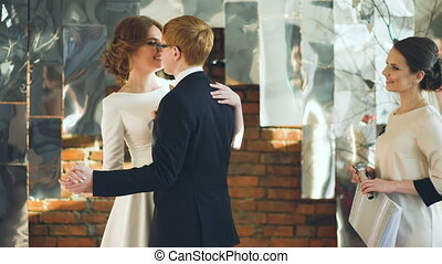 Newlyweds dancing their first dance after wedding ceremony...