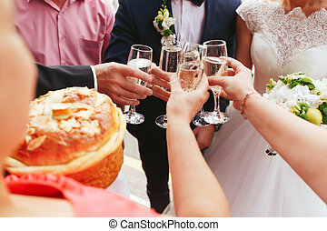Newlyweds drink champagne with guests