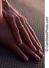 Newlyweds hands with wedding rings on the finger