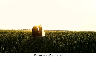 Newlyweds hugging in a wheat field