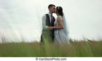 Newlyweds in a green field