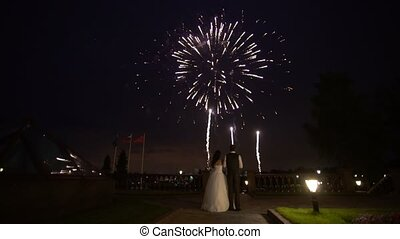 Newlyweds looking at firework shot