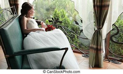 Newlyweds looking at the rain