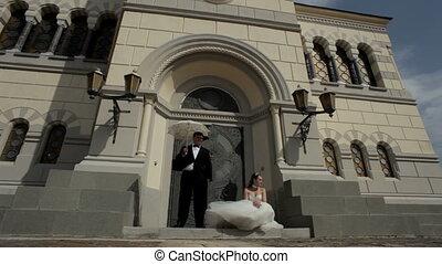 Newlyweds near palace