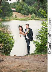 Newlyweds near the river