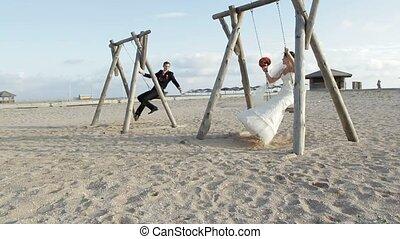 Newlyweds On A Swing