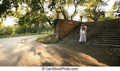 newlyweds on nature - Happy newlyweds kissing on nature