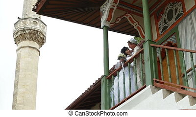 newlyweds on  steps of  mosque