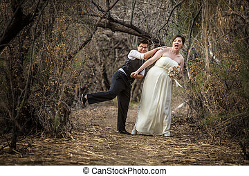 Newlyweds Playing in Forest