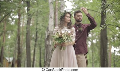 Newlyweds posing photographer nature - Cute bride groom...
