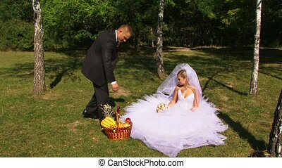 Newlyweds Relax In Nature - The newlyweds had a picnic in...