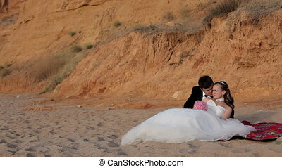 Newlyweds relax on the beach