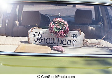 Newlyweds signboard car - a beautiful bouquet of pink roses...