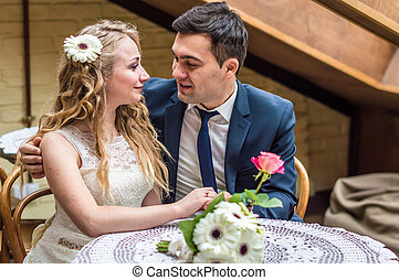 newlyweds sitting in the Cafe