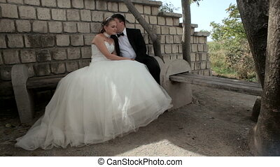 Newlyweds talking on the bench