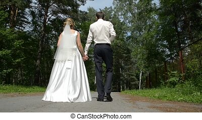 Newlyweds walk in the park