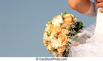 Newlyweds with a bouquet