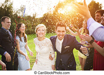 Newlyweds with guest on their garden party - Full length ...