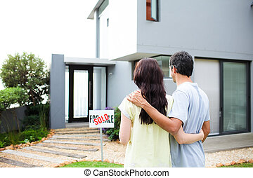 Newlyweds with their new house - Happy newlyweds with their ...
