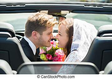 Newlyweds Young Couple Kissing In The Car