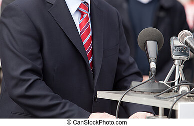 news conference - Microphone where a speaker is about to...