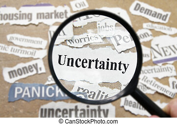 News headlines and magnifying glass with Uncertainty text