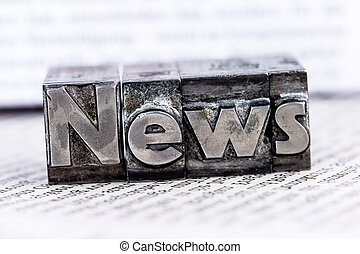 news in lead letters - the word news written with lead...
