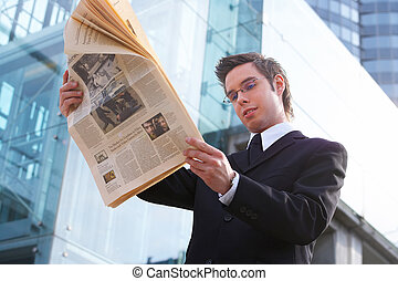 news - businessman reads the newspaper