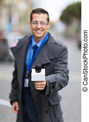 news reporter doing interview outdoors - professional news...