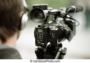 news shooting - professional camcorder on the tripod,...