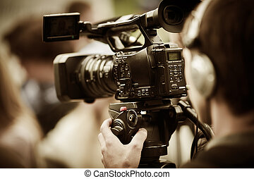 news shooting - professional camcorder on the tripod, ...