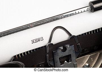 News text on typewriter